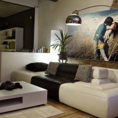 Niestadt-Fotografie-Schoonhoven-Framefoto-print-op-doek-in-frame-boven-de-bank-in-woonkamer